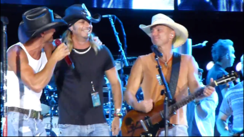 Tim McGraw, Bret Michaels, Kenny Chesney on stage at a Kenny Chesney Show